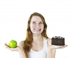 9434393-tempted-young-woman-holding-apple-and-chocolate-cake-making-a-choice